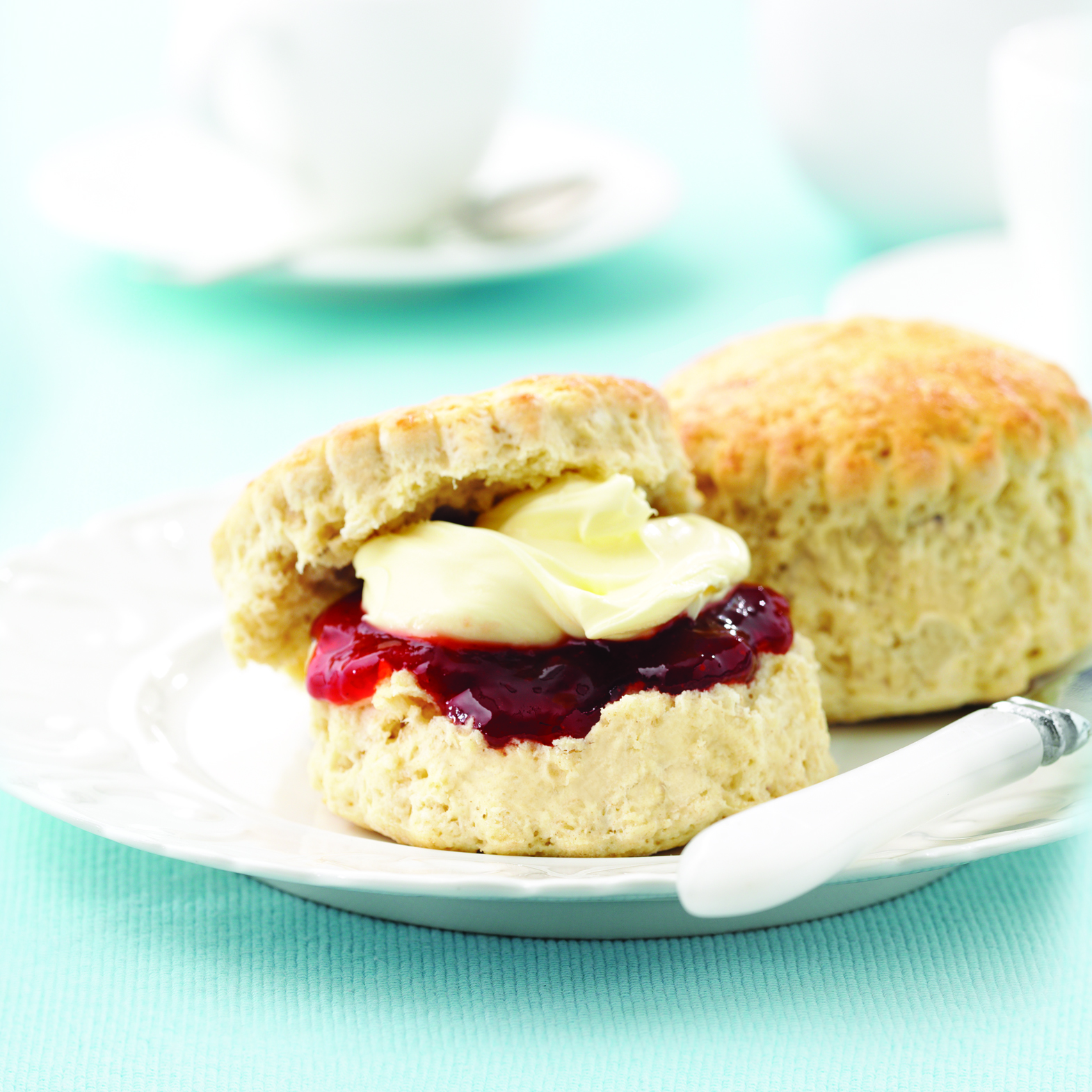 Cream and Jam scones on plate
